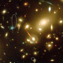 [Abell 2218, with lenses of the most distant galaxy circled]